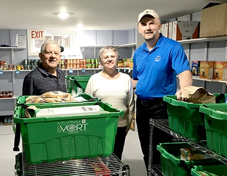 Peter (right) sorts food hampers and delivers them to families in need on a regular basis.
