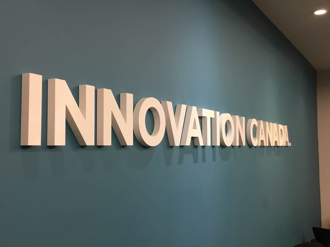 innovation canada sign on a blue wall